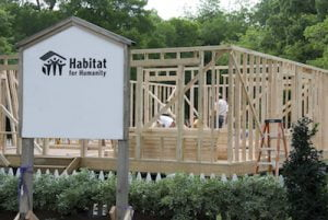 studios donate plywood to habitat for humanity