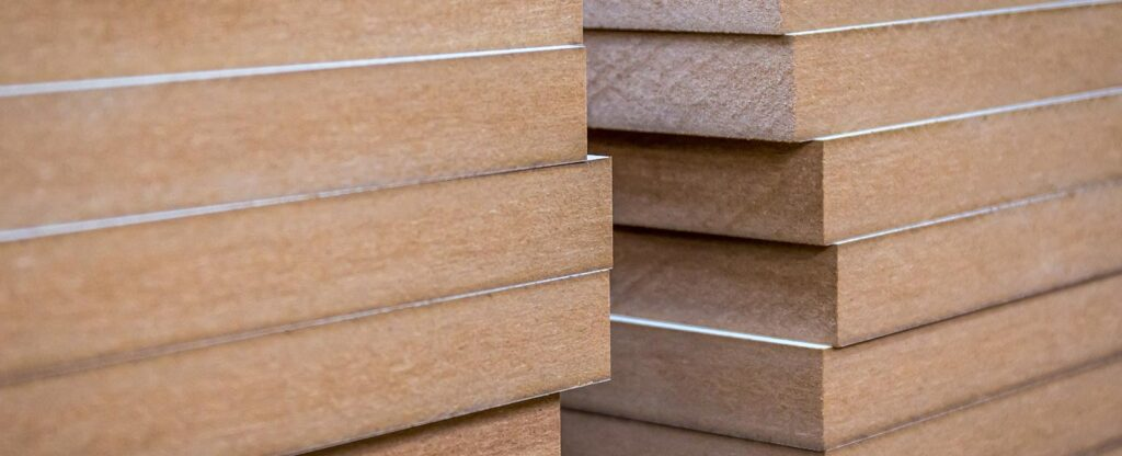 Stacks of medium density fibreboards
